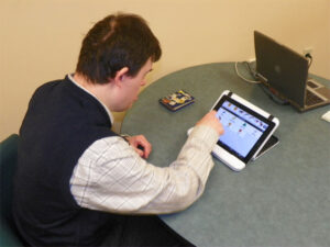 Individual using ipad for speech therapy
