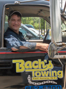 Individual working with Bachs Towing Company