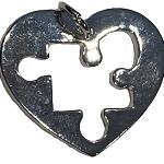 Autism puzzle piece cut out heart charm